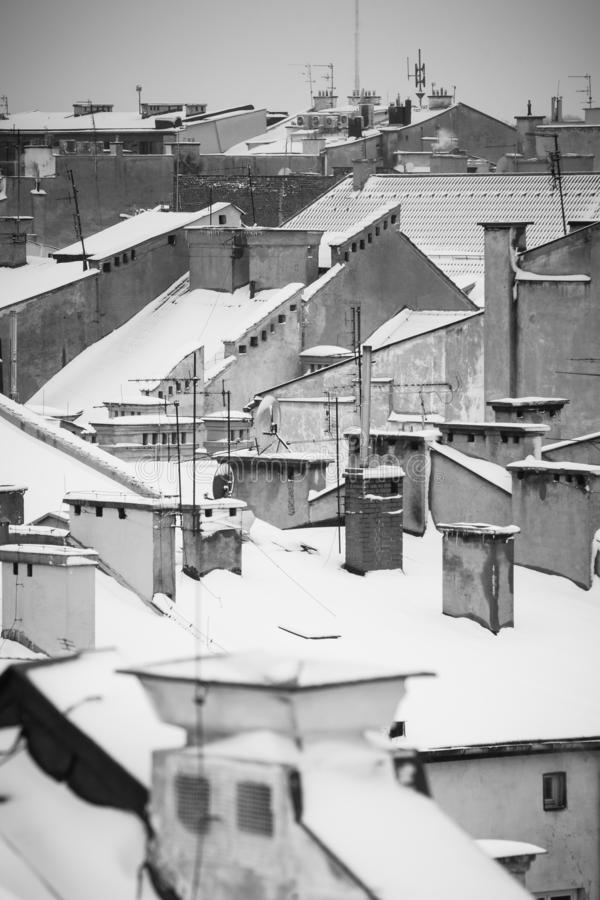 Krakow in Christmas time, aerial view on snowy roofs in central part of city. BW photo. Poland. Europe.  royalty free stock photo