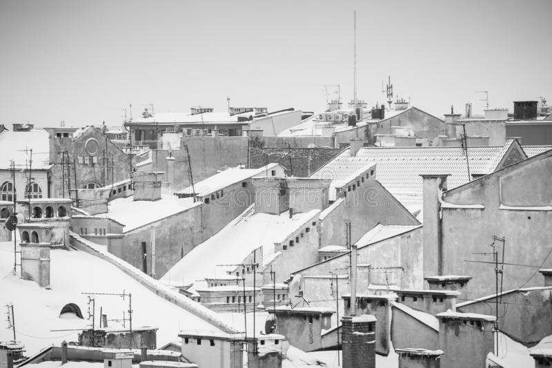 Krakow in Christmas time, aerial view on snowy roofs in central part of city. BW photo. Poland. Europe. Ancient architecture beautiful building castle cathedral royalty free stock photos
