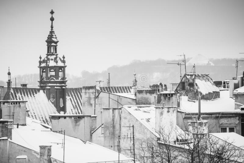 Krakow in Christmas time, aerial view on snowy roofs in central part of city. BW photo. Poland. Europe. Ancient architecture beautiful building castle cathedral stock images