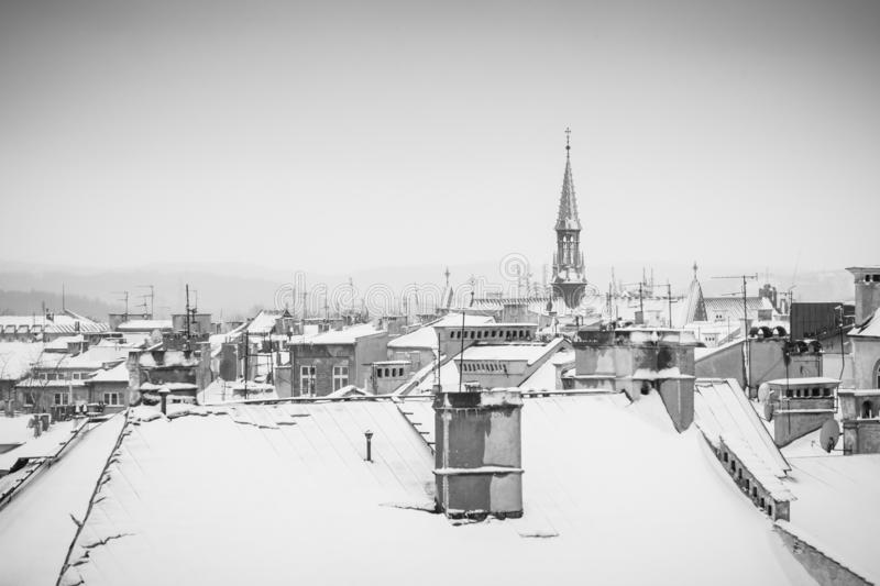 Krakow in Christmas time, aerial view on snowy roofs in central part of city. BW photo. Poland. Europe. Ancient architecture beautiful building castle cathedral stock photos