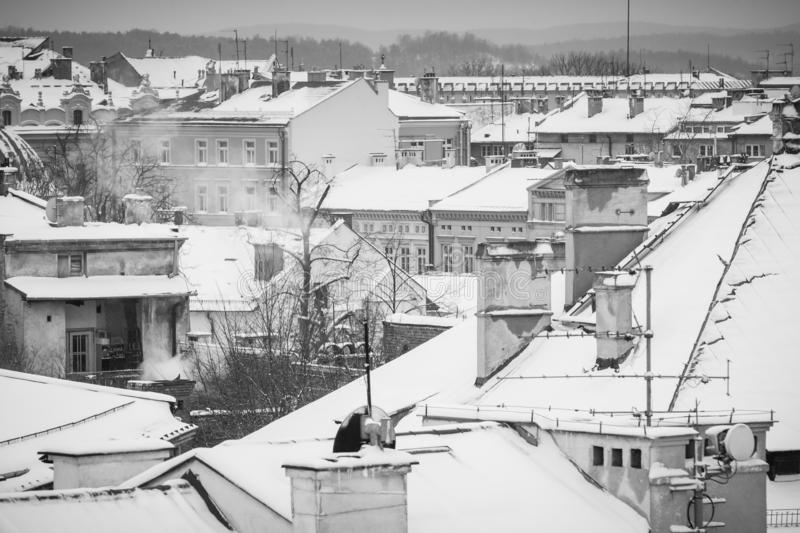 Krakow in Christmas time, aerial view on snowy roofs in central part of city. BW photo. Poland. Europe. Ancient architecture beautiful building castle cathedral royalty free stock photo