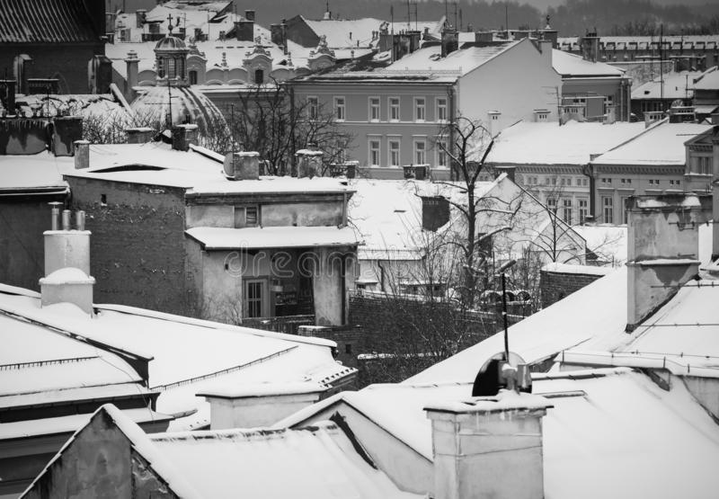 Krakow in Christmas time, aerial view on snowy roofs in central part of city. BW photo. Poland. Europe. Krakow in Christmas time, aerial view on snowy roofs in royalty free stock photography