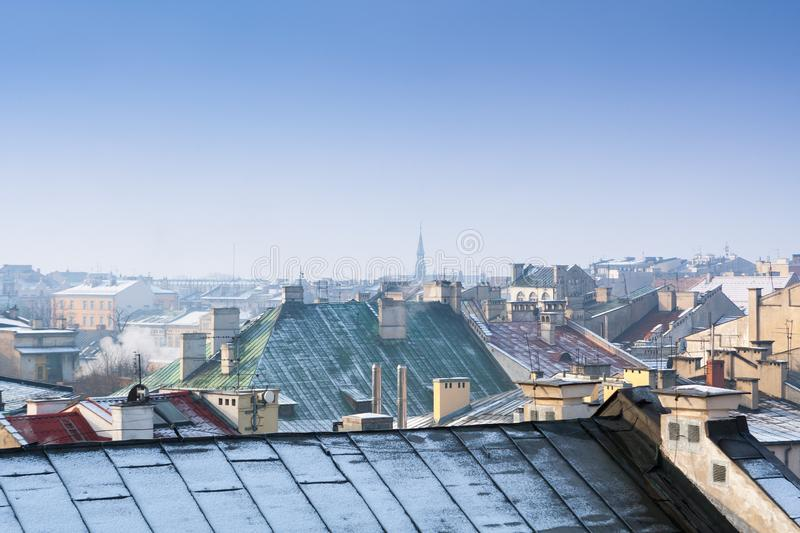 Krakow in Christmas time, aerial view on snowy roofs in central part of city. Poland. Europe. Krakow in Christmas time, aerial view on snowy roofs in central royalty free stock photo