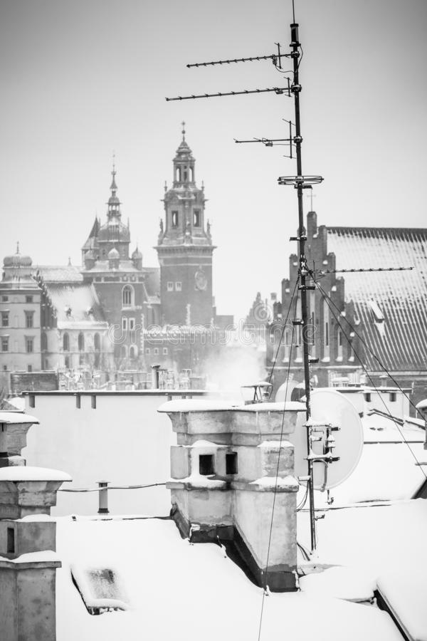 Krakow in Christmas time, aerial view on snowy roofs in central part of city. Wawel Castle and the Cathedral. BW photo. Poland. Europe royalty free stock images
