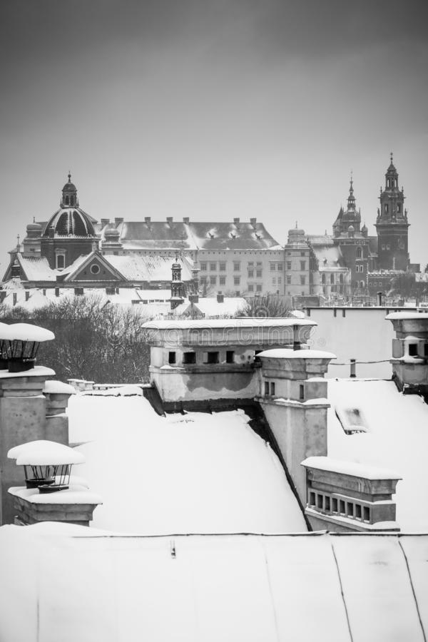 Krakow in Christmas time, aerial view on snowy roofs in central part of city. Wawel Castle and the Cathedral. BW photo. Poland. stock photos