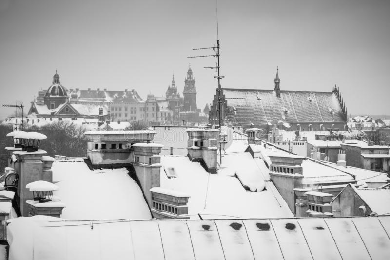 Krakow in Christmas time, aerial view on snowy roofs in central part of city. Wawel Castle and the Cathedral. BW photo. Poland. Europe royalty free stock image