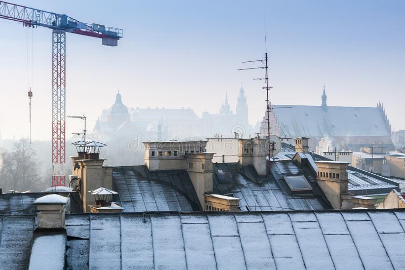 Krakow in Christmas time, aerial view on snowy roofs in central part of city. Wawel Castle and the Cathedral. Poland Europe. Krakow in Christmas time, aerial stock image