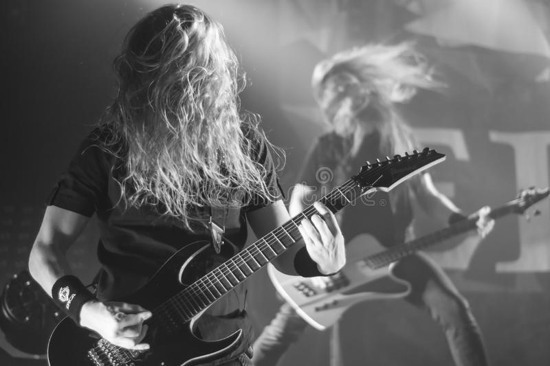 Krakow December 2017 a Metal rock guitar duo performs on stage stock photos