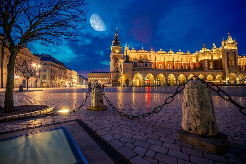 Krakow Main Market Place. After Dark with Moon on the Sky. Cracow, Lesser Poland, Europe royalty free stock photography