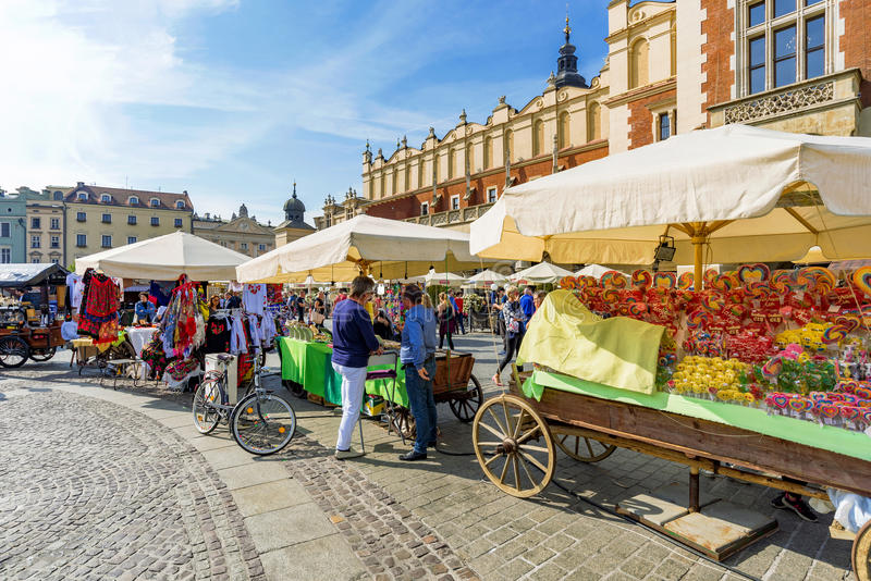 Krakow main square market. KRAKOW, POLAND - OCTOBER 02: These are market stalls in the main square of Krakow city center where many tourists come to buy stock photo