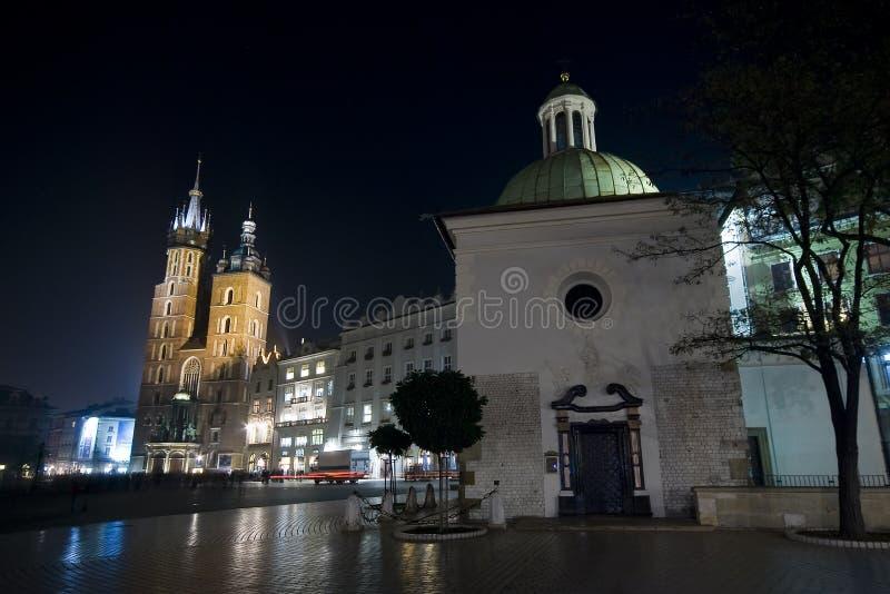 Krakow main square at night. Churches of St Mary and St Adalbert on the Krakow main square at night stock photo
