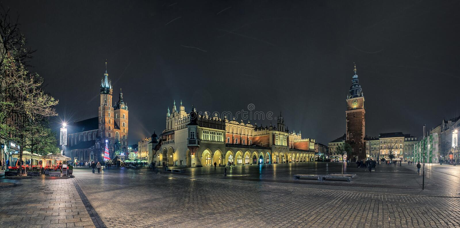 Krakow main square. Krakow, Poland, panorama shows the main monuments in the main square, from the left: St. Mary's Church, the old market hall Sukiennice and stock image
