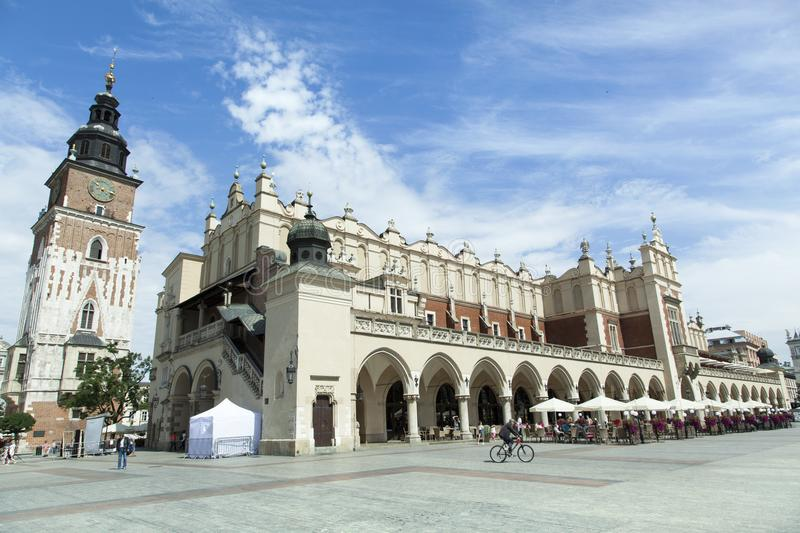 Krakow Main Square. The view of 13th century Krakow Main Square with clock tower and historic Cloth Market Poland royalty free stock image