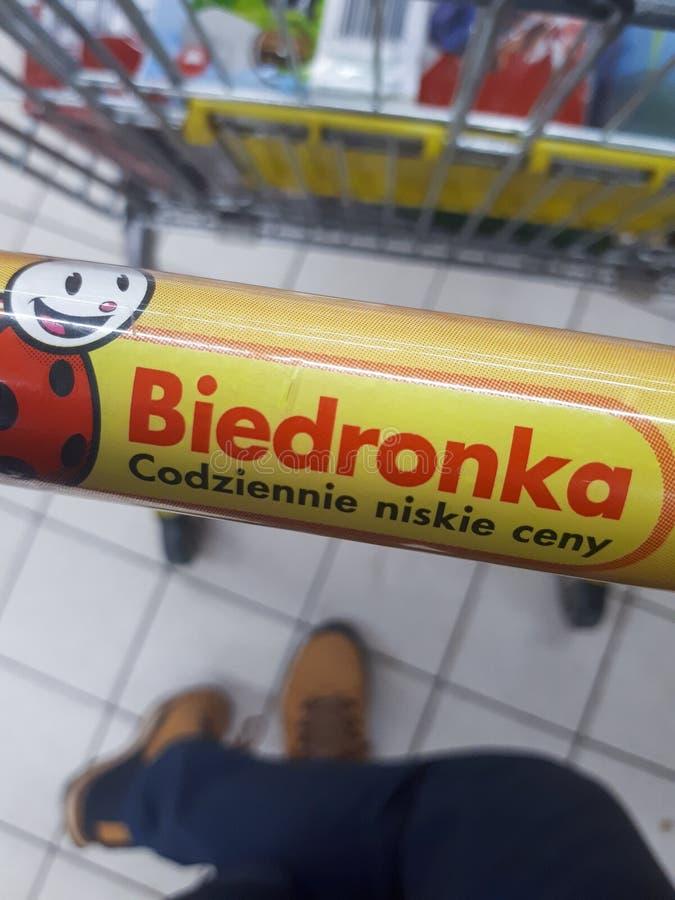 Krakow Poland - April 3, 2020: Biedronka store logo on a shopping trolley. Handle stock photography