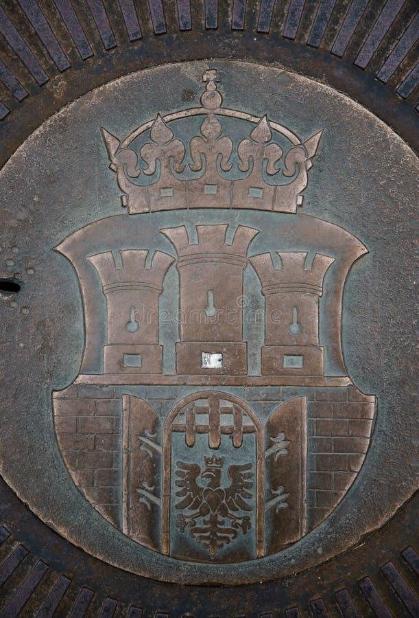 Medieval Polish coat of Arms. KRAKOW,POLAND-23 APRIL,2019: Symbol of old town Krakow on metal manhole on market square.Ancient medieval Polish coat of arms stock photography