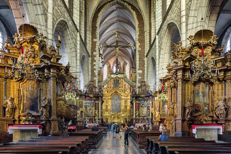 Corpus Christi Basilica in Krakow, Poland. KRAKOW, POLAND - AUGUST 18: Golden altar on Corpus Basilica on August, 18, 2018 in Krakow stock photography