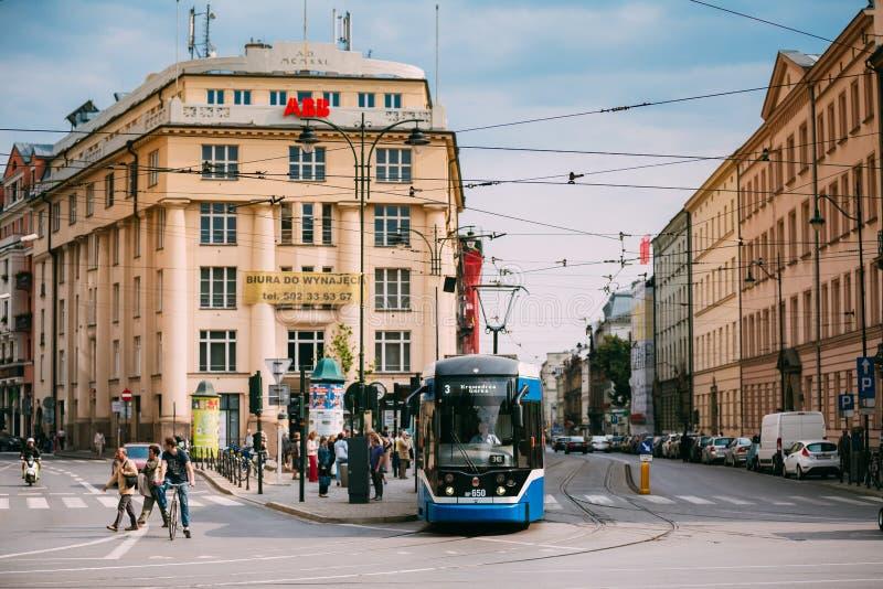 Krakow, Poland. Blue Public Tram On Starowislna Street In Krakow stock photo