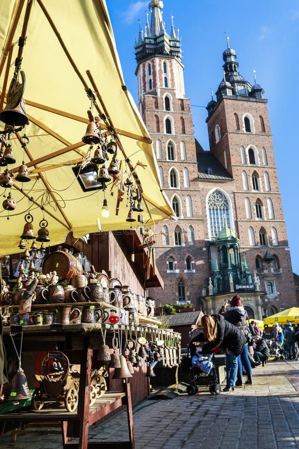 KRAKOW,POLAND - DECEMBER 02, 2015: Annual christmas fair at the Main Market Square. Annual christmas fair at the Main Market Square and Mariacki church, Church royalty free stock image
