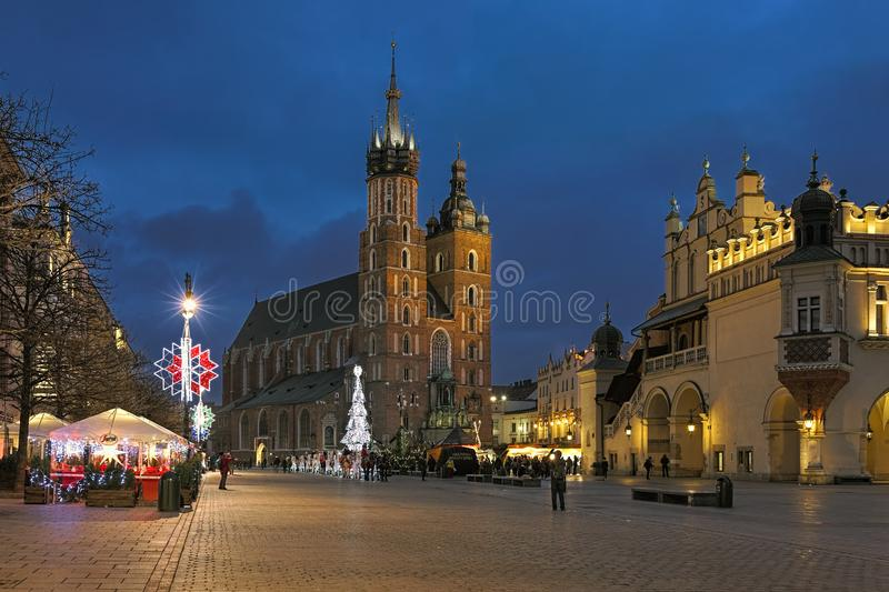 Main Square of Krakow with Christmas market in dusk, Poland royalty free stock images