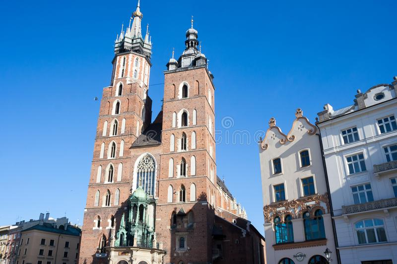 Old city center view with Adam Mickiewicz monument and St. Mary`s Basilica in Krakow stock photo