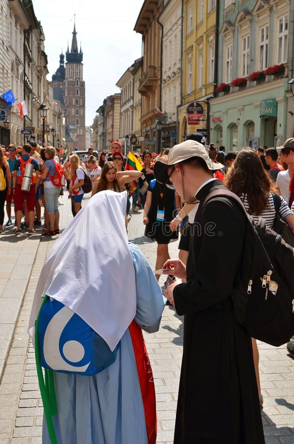 KRAKOW, POLAND - JUL 27, 2016: World youth day 2016.International Catholic youth Convention. Young people on Main Square in Krakow royalty free stock photography