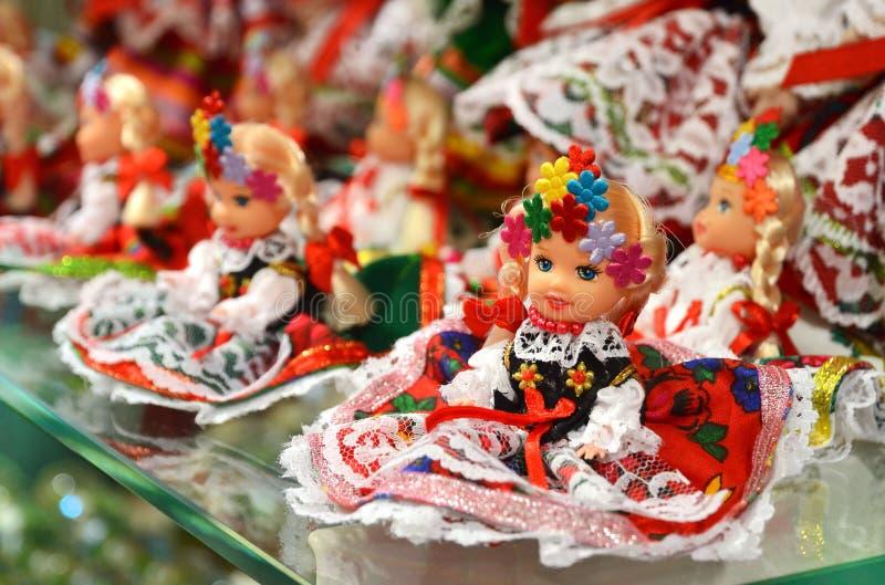 KRAKOW, POLAND - JULY 5, 2016: Vendor sells Polish traditional handicraft souvenirs in Sukiennice (Cloth Hall). KRAKOW, POLAND - JULY 5, 2016: Vendor sells royalty free stock images