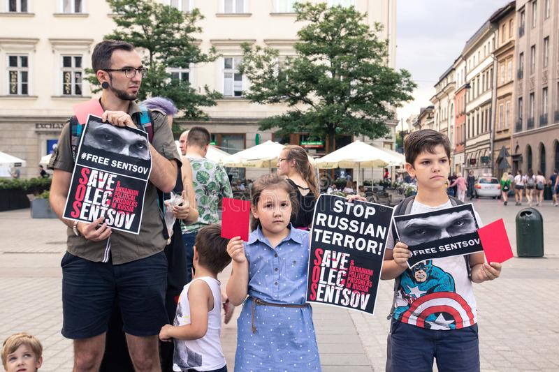 Krakow, Poland, June 01, 2018, Children with parents holding posters and red cards protest against Russian political prisoners stock image