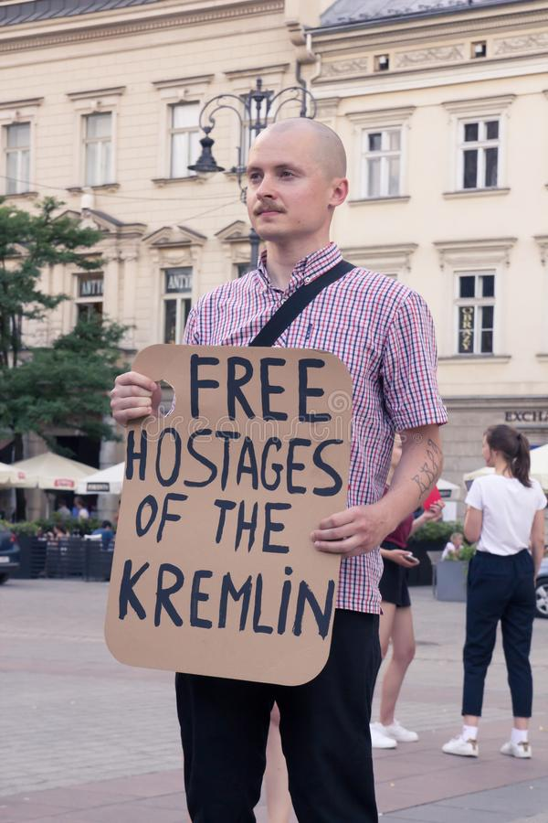 Krakow, Poland, June 01, 2018, One man with a poster protesting. Against political prisoners in Russia, Free kremlins hostages stock photo