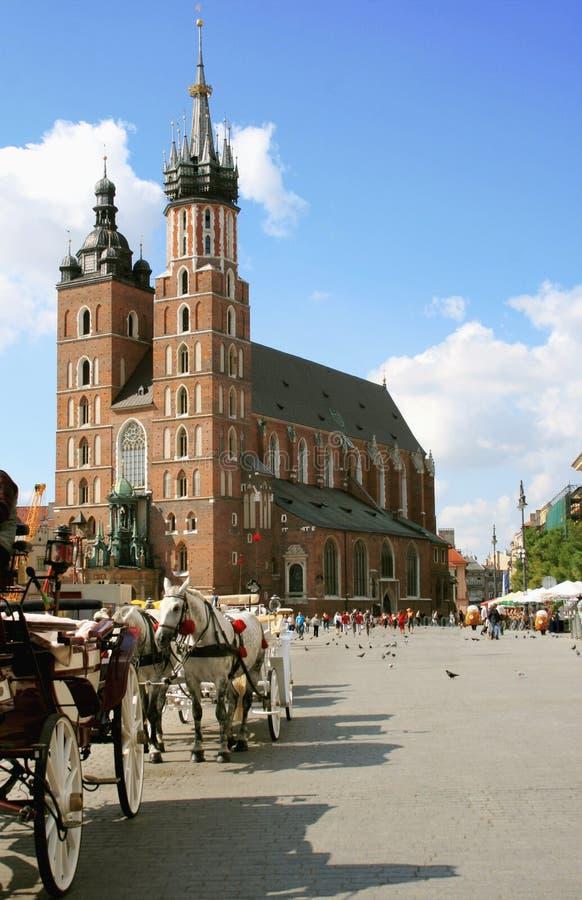 Krakow, Poland - main market square. And St.Marys Church royalty free stock photos