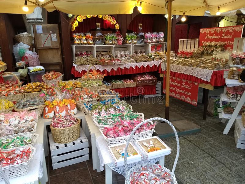 Krakow / Poland - March 23 2018: Easter fairs on the market Rynok square in Krakow. Kiosks with souvenirs, sweets and food. stock photo