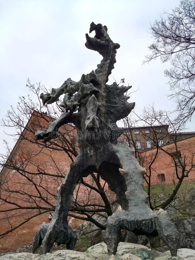Krakow / Poland - March 23 2018: Sculpture of a dragon exhaling fire every 3-4 minutes stock photo