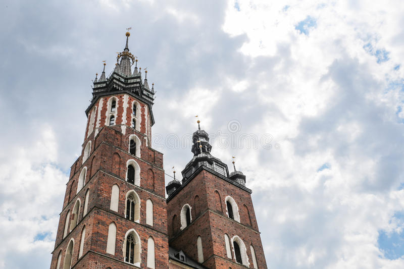 Krakow, Poland- May 25, 2016: Church of Our Lady Assumed into Heaven. Is a Brick Gothic church re-built in the 14th century. With tourists on square stock images
