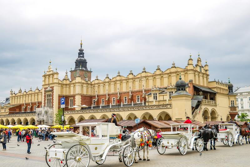 Krakow, Poland - May 21, 2019: Horse carriages at main square in Krakow royalty free stock photo