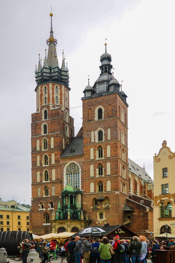 Krakow, Poland - May 21, 2019: St Mary`s Basilica and Main Market Square in Krakow royalty free stock image