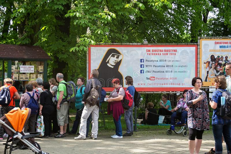 KRAKOW, POLAND - MAY 28, 2016: Tourists and Pilgrims in park near Basilica of the Divine Mercy of Sanctuary in Lagiewniki. royalty free stock images