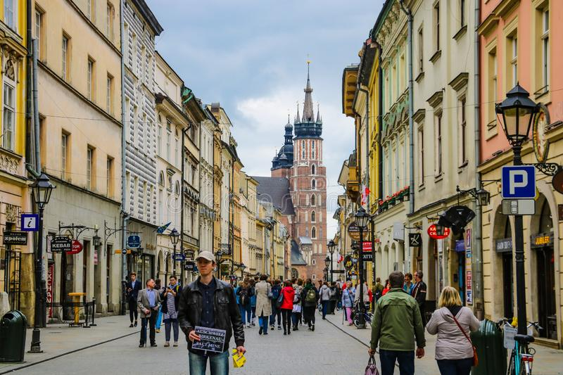 Krakow, Poland - May 21, 2019: Tourists walking through the old city of Krakow stock photography