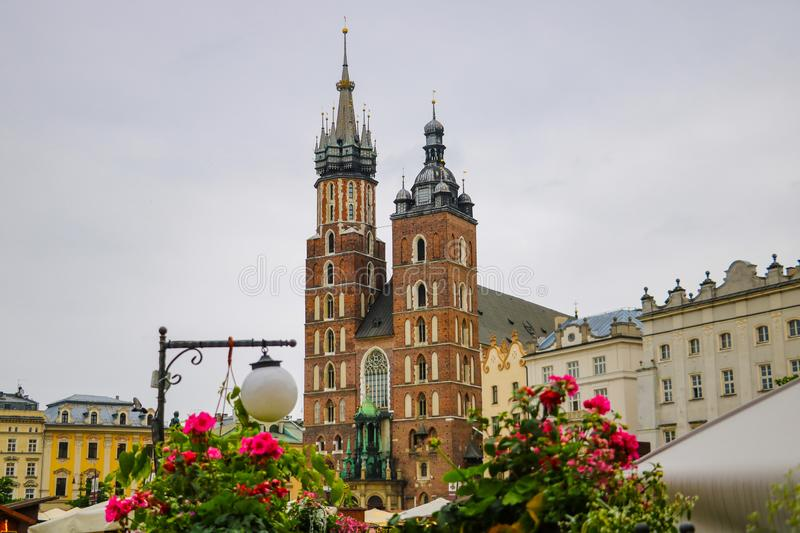Krakow, Poland - May 21, 2019: View of flowers in the foreground, in the background the church is out of focus royalty free stock image