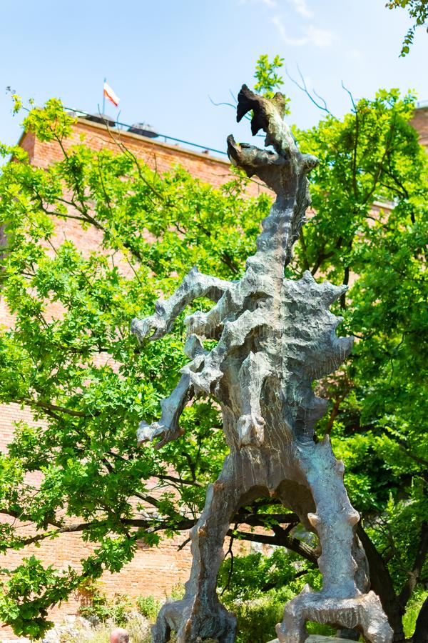 Krakow, Poland, May 10 2019 - Wawel Dragon Statue breathing fire at the foot of the Wawel Hill, Krakow, Poland royalty free stock photo
