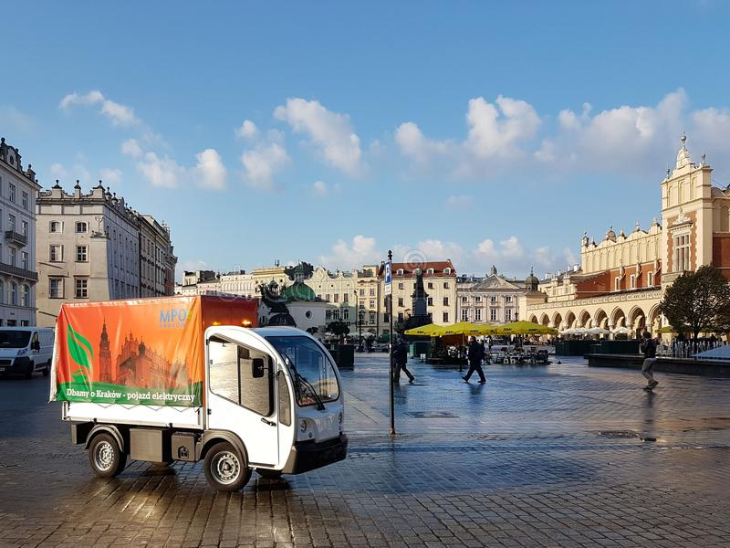 Krakow, Poland - 09. 13. 2017: Morning town after the rain. Bright sunny day. Morning cleaning of the street stock image