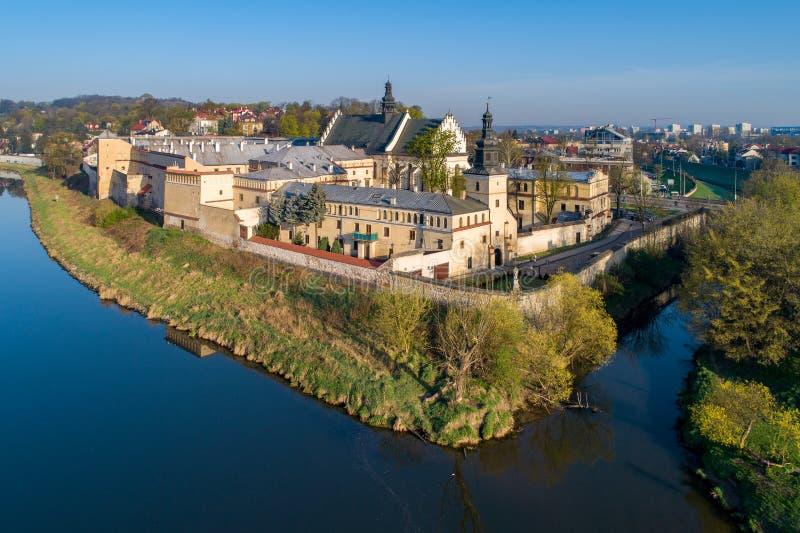 Krakow, Poland. Norbertine convent and Vistula river. Aerial. Krakow, Poland. Norbertines - female convent, church, Vistula and Rudawa rivers and far view of stock photos