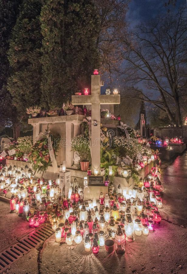 Franciscans` tomb and cross of the victims of communism, Salwator Cemetery, Krakow, Poland, All Saints` Day stock photography