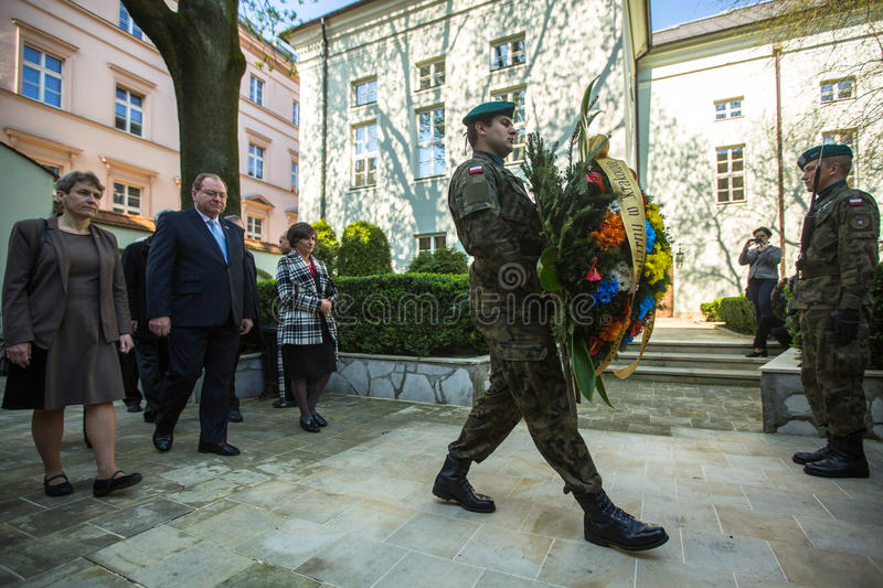 KRAKOW, POLAND - Officials at ceremony of laying flowers to the monument to Hugo Kollataj. KRAKOW, POLAND - MAY 3, 2015: Officials at ceremony of laying flowers royalty free stock images