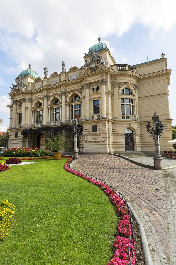 KRAKOW, POLAND - SEPTEMBER 9, 2018: Juliusz Slowacki Theatre, 19th century eclectic building, flowerbed. royalty free stock photo