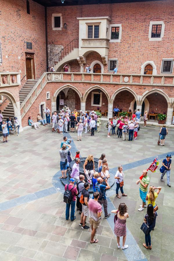 KRAKOW, POLAND - SEPTEMBER 3, 2016: People visit Collegium Maius Great College courtyard of the Jagellonian University royalty free stock photos