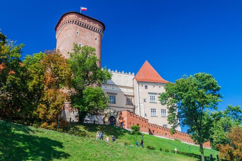 KRAKOW, POLAND - SEPTEMBER 4, 2016: People walk in front of Wawel castle in Krakow, Polan royalty free stock photo