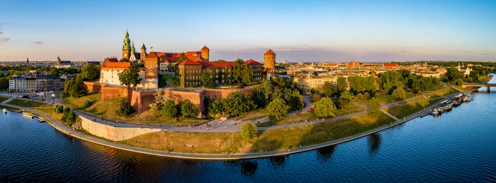 Wide Panorama of Krakow, Poland, Wawel castle and Vistula river. Krakow, Poland. Wide aerial panorama at sunset with Royal Wawel castle and cathedral. Far view stock photos