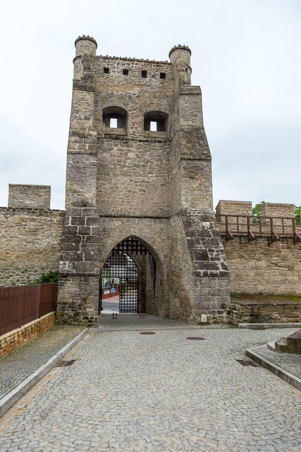 Krakowska Gate, part of the defensive walls, Szydlow, Poland. Szydlow, Poland- 23 May 2015: Krakowska Gate, part of the defensive walls guarding access to the stock image