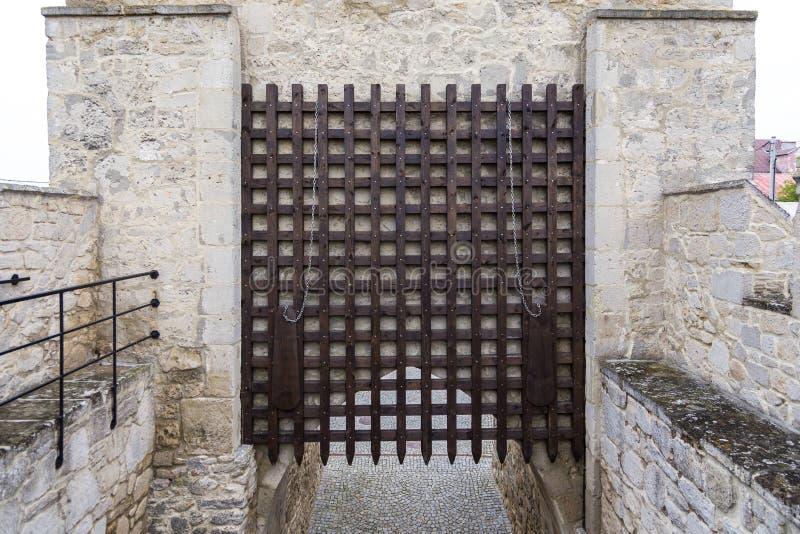 Krakowska Gate, part of the defensive walls, Szydlow, Poland. Szydlow, Poland- 23 May 2015: Krakowska Gate, part of the defensive walls guarding access to the stock photos