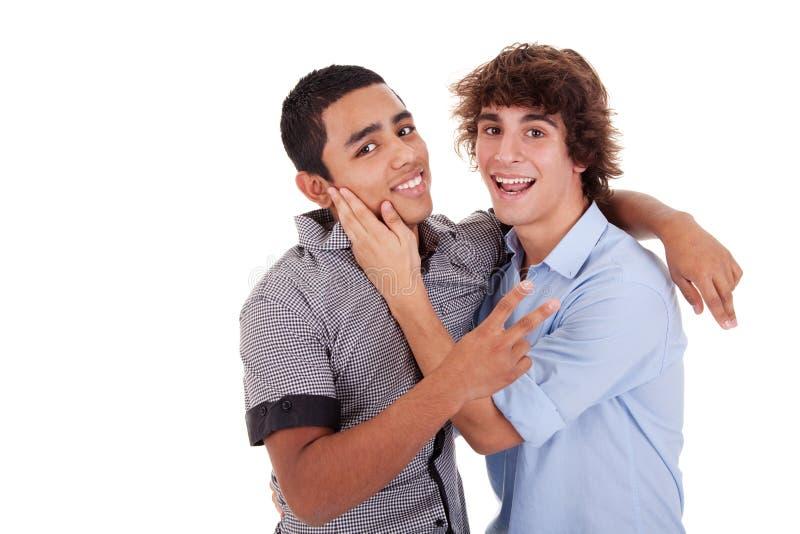 krama skratta män två barn fotografering för bildbyråer