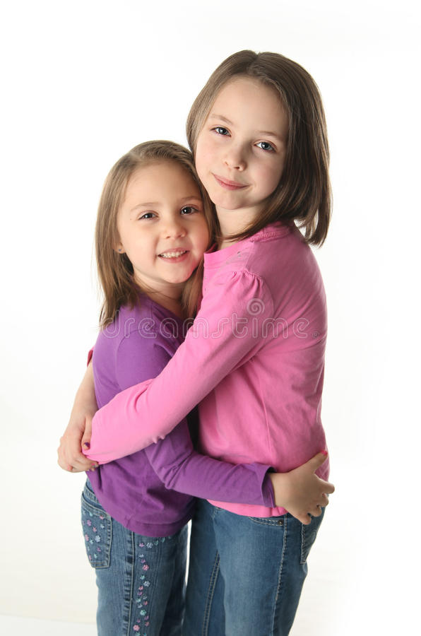 krama systrar två royaltyfria foton